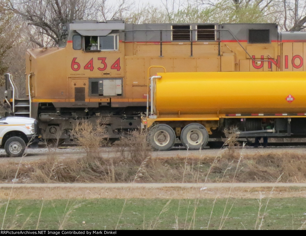 On a cold November morning, Union Pacific AC44CW no. 6434 takes on fuel east of town with an eastbound coal train