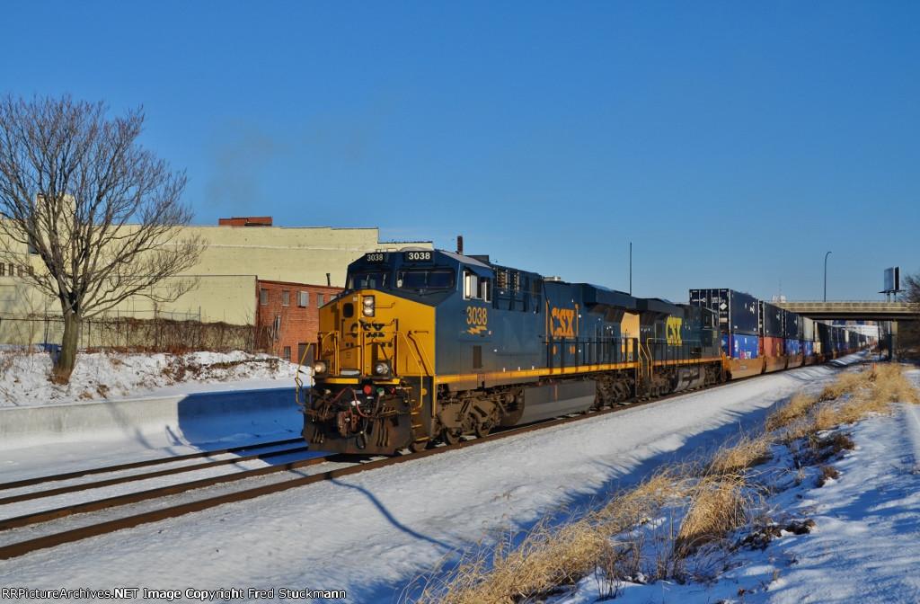 CSX 3038 runs west on track 2.