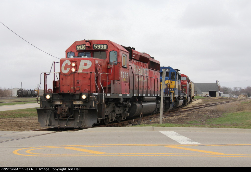 273 uses a remainder of the Chicago Great Western to spot a car for Glendenning Fertilizer