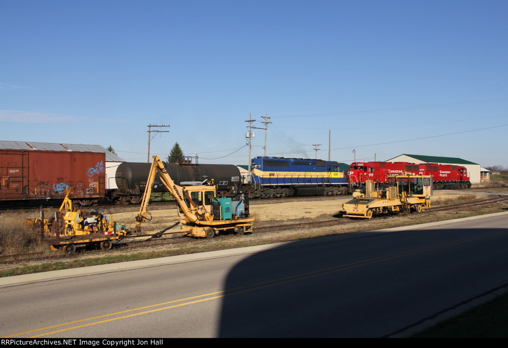 Stored MOW equipment watches the passage of 470