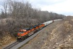 BNSF 1012 & 4562 head east through the cut with H-NTWBRC