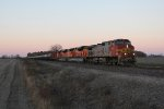 BNSF 758 and a pair of newer ACe's roll east on the Aurora Sub with an oil train