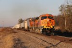 The fresh H3 paint on BNSF 4021 shines under the morning sun as it leads Z-STPCHC east