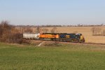 CSX 8524 & BNSF 5719 come across the autumn countryside with the 472