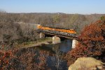 BNSF 6563 makes good speed eastbound across the Rock River with the V-PTLLPC
