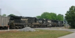 NS 7629 leads unit train of coal hoppers,