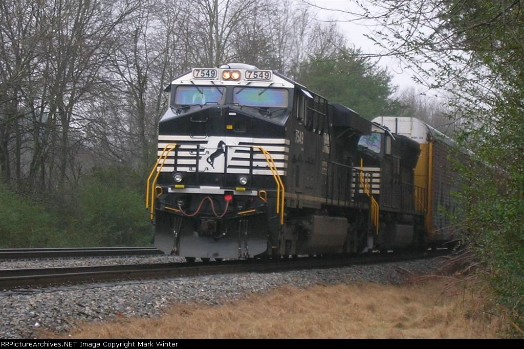 NS 7549 leading autorack train, NB, waiting for clearance,