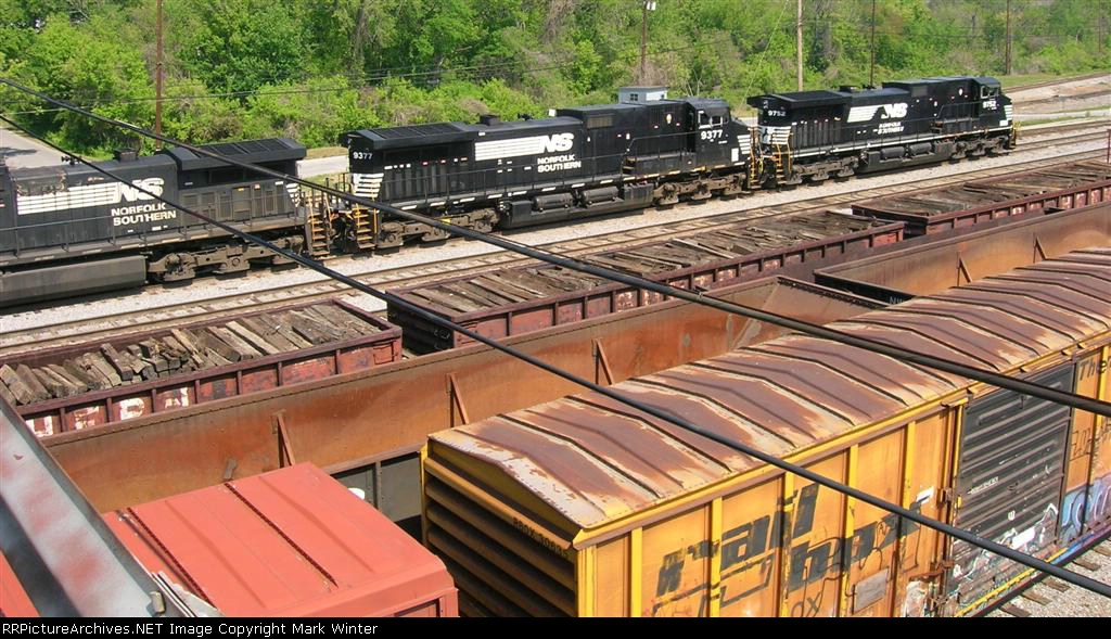 NS 9752, NS 9377, and other units near the tower at the hump yard,