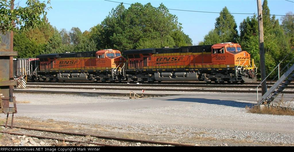BNSF 5800 and BNSF 5783 leading empty unit coal train, waiting on mainline