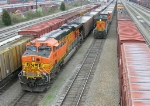 BNSF 5740 and BNSF 5672 each leading a string of empty RWSX hoppers
