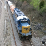 CSX 6087 with short line of tank cars headed toward its yard