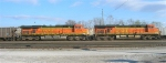 BNSF 5737 and BNSF 5729 idling at the head of HBWX hopper train in the yard