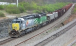 "CSX 4601 ""Seaboard System"" and BNSF 6778 lead ballast hoppers"