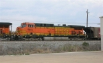 BNSF 5661, in the no. 2 position on HYWX coal train, sitting at the signal