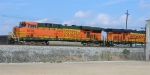 BNSF 5735 and BNSF 5790 leading empty RWSX coal train, waiting at signal on mainline