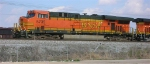 BNSF 5735, waiting at signal, with empty RWSX coal train