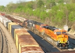 BNSF 5883 leading mixed freight on mainline