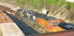 The 2 cars behind BNSF 4957 and NS 5005 are carrying panel track,