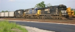NS 8888 leading SB unit coal train of loaded SMEX hoppers, sitting in the yard