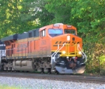 BNSF 7605 and NS units lead NB mixed freight in the early evening