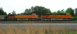 BNSF 5810 and BNSF 5703 with empty RWSX unit coal train, sitting on the mainline,