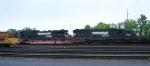 NS 6698 and NS 8787 at head of mixed freight in yard, in early morning, SB,