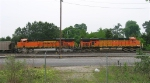 BNSF 5745 and BNSF 5836 leading RWSX empty coal train, sitting on main line,