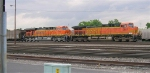 BNSF 5651 and BNSF 5767 sitting the yard at front of empty coal train,