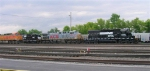 NS 6095 and KCS 4602 lead a string of locos out of the yard