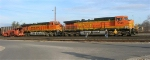BNSF 5646 and BNSF 5941 at head of empty coal train, in yard,