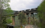 NS 9912 in lead WB on high bridge over Interstate 24,
