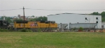 CNW 471037 on siding as UP 4979 rolls by