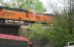 BNSF 5796 and BNSF 6004 at tail of loaded coal train,