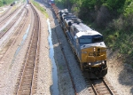CSX 5327 leading stack train, while BNSF unit coal train approaches on NS main