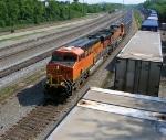 BNSF 5929 leads empty unit coal train on NS main