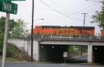 BNSF 5756 leading empty unit coal train, waiting on NS mainline