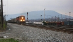 BNSF 6022 getting up to speed, leading loaded unit coal train