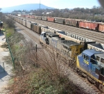 CSX 9029 and CSX 7390 leade mixed freight on CSX mainline