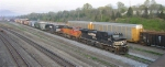 NS 8904 and BNSF 4504 leading short freight NB out of yard,