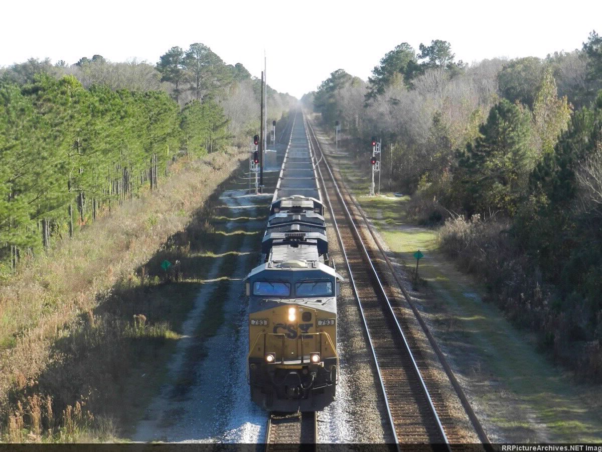 Northbound CSX 793 is on the point of a long line of empty coal cars approaching the US 301 viaduct just south of Callahan Junction