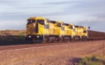 CNW units only a few months old lead empty coal train.