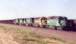 BN Coal train heads south with loads near Bill, Wyoming