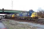 CSX 163 backs to take the lead of his train