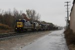 CSX 7604 leads Q335 toward Pleasant St on a gloomy and damp day