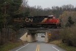 CN 2235 rolls over Buttrick Ave as it leads Q335 west
