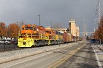 Z151 rolls south along Winter Ave as the dark clouds of passing lake effect snow showers loom to the north