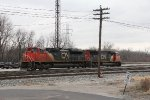 CN 8858 & 5628 sit at the west end of Wyoming between switching cuts of cars with Y103