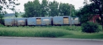 Blue Consolidated Paper boxcars in woodchip service