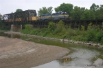 ICE 6403 and DME 6070 lead ballast hoppers over Cottonwood River bridge EB