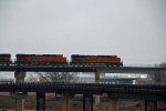 BNSF 7493 Heads up a stack train.